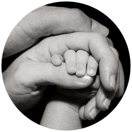 Emotional support for families. Father, mother and baby holding hands.